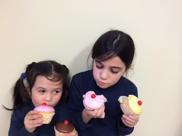 Kids eating Red Nose Day Cup Cakes baked by Glenroy Bakery